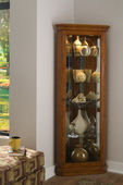 Aqua Pear Sundance Deluxe Corner Curio Cabinet in Golden Oak II Finish  JPK3030